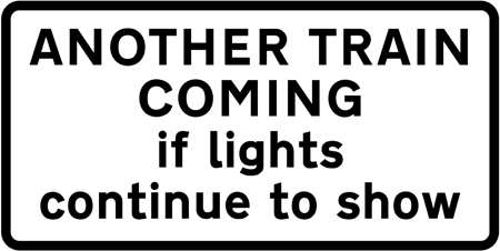 level-crossing-signs - another train coming if lights continue to show