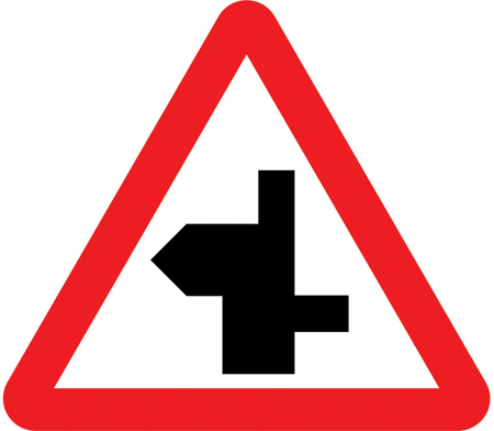 warning-signs - left bend staggered crossraod