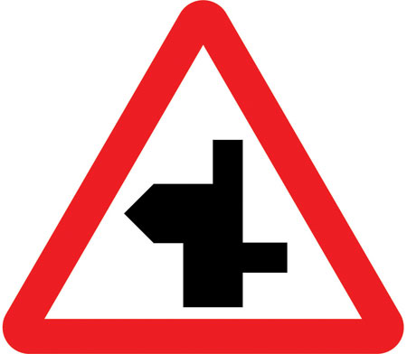 warning-signs - staggered crossroad left bend