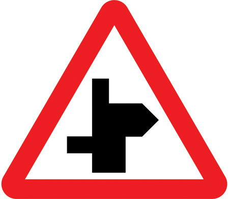 warning-signs - staggered crossroad right bend
